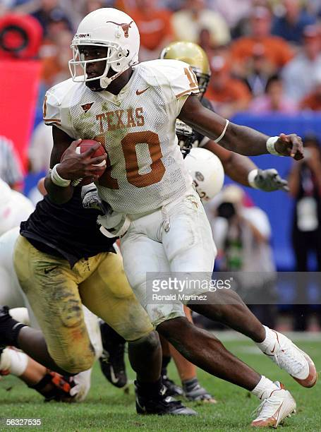 Quarterback Vince Young of the Texas Longhorns runs against the Colorado Buffaloes during the Dr Pepper Big 12 Championship at Reliant Stadium...