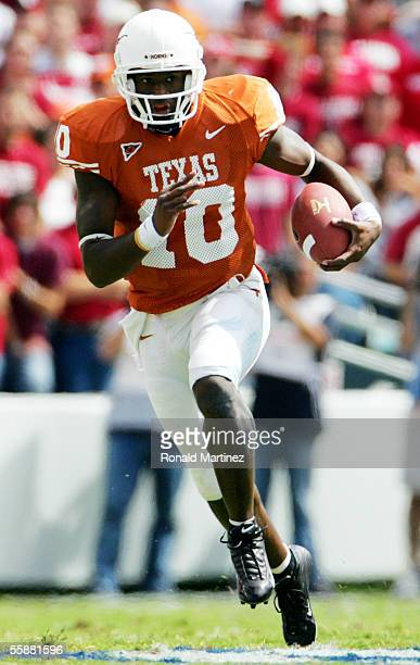 Quarterback Vince Young of the Texas Longhorns runs the ball against the Oklahoma Sooners on October 8 2005 at the Cotton Bowl in Dallas Texas The...