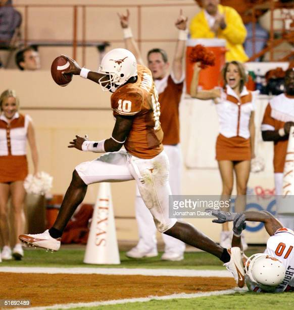 Quarterback Vince Young of the Texas Longhorns scores a second-half touchdown over Thomas Wright of the Oklahoma State Cowboys during a game on...