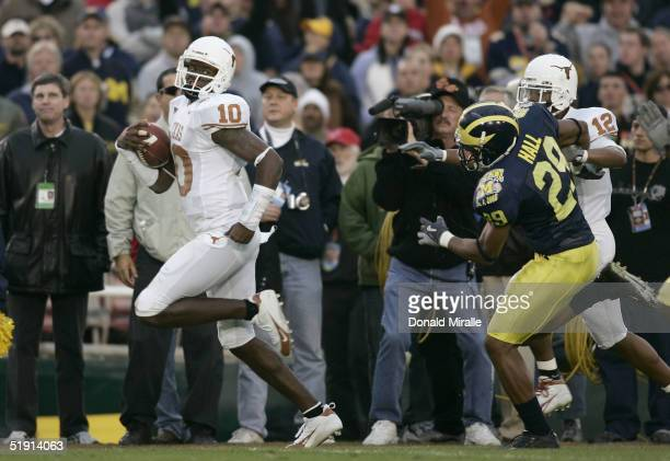 Quarterback Vince Young of the Texas Longhorns scores his second rushing touchdown past Leon Hall of the Michigan Wolverines in the 91st Rose Bowl...