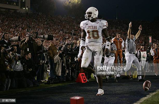 Quarterback Vince Young of the Texas Longhorns scores his third rushing touchdown of the game against the Michigan Wolverines in the 91st Rose Bowl...