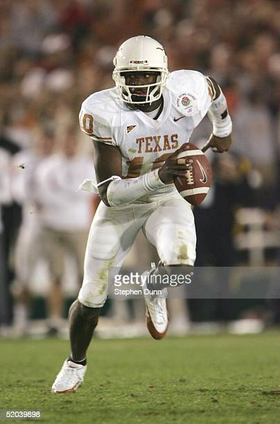 Quarterback Vince Young of the Texas Longhorns scrambles against the Michigan Wolverines in the 91st Rose Bowl Game at the Rose Bowl on January 1,...