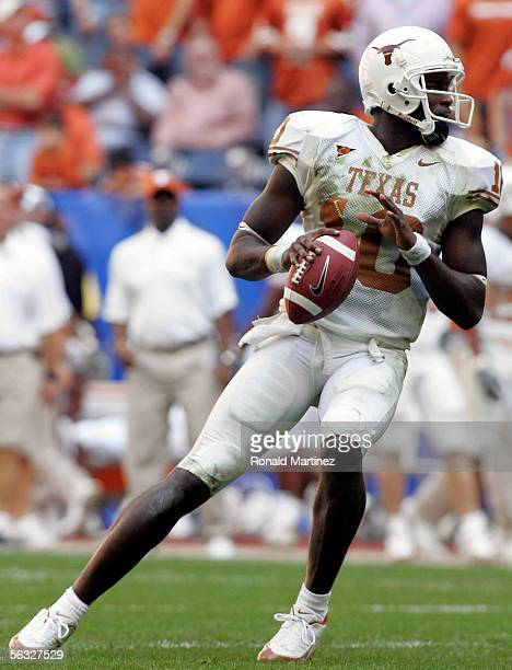 Quarterback Vince Young of the Texas Longhorns throws a touchdown pass against the Colorado Buffaloes during the Dr. Pepper Big 12 Championship at...