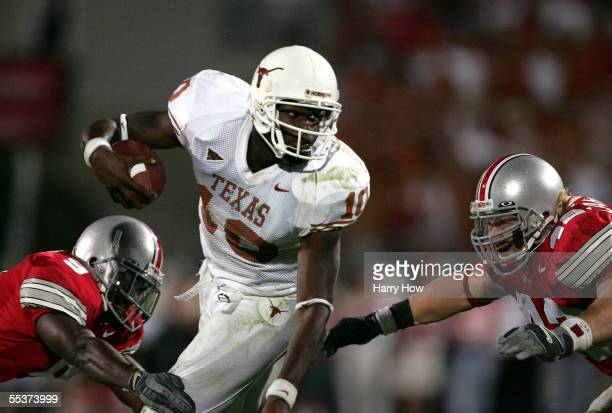 Quarterback Vince Young of the Texas Longhorns tries to slip the tackle of strong safety Donte Whitner and linebacker Bobby Carpenter of the Ohio...