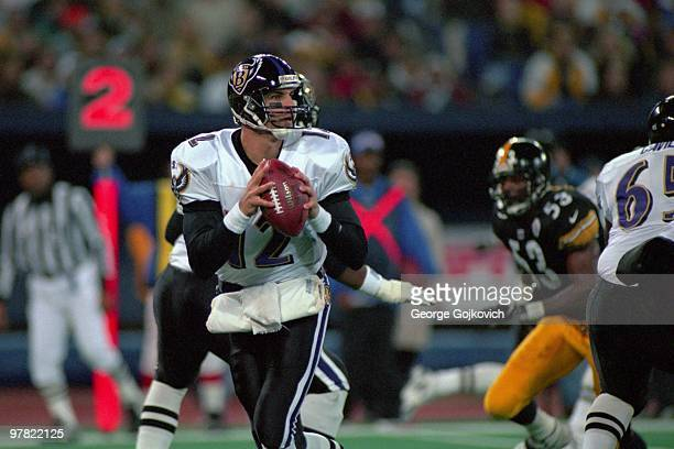 Quarterback Vinny Testaverde of the Baltimore Ravens looks to pass against the Pittsburgh Steelers during a game at Three Rivers Stadium on November...
