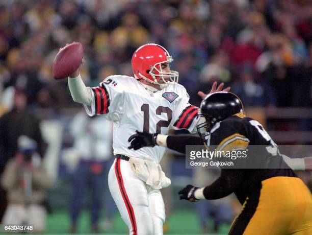 Quarterback Vinny Testaverde of the Cleveland Browns looks to pass while under pressure during a playoff game against the Pittsburgh Steelers at...