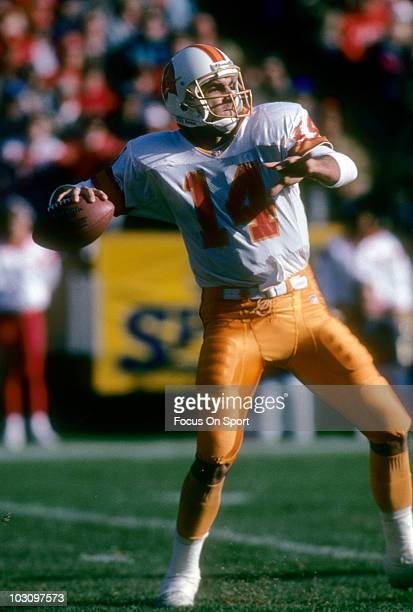 Quarterback Vinny Testaverde of the Tampa Bay Buccaneers drops back to pass against the San Francisco 49ers December 19 1992 during an NFL football...