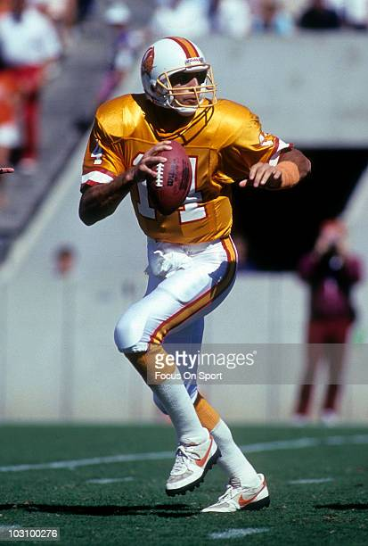 Quarterback Vinny Testaverde of the Tampa Bay Buccaneers rolls out to pass circa 1990 during an NFL football game at Tampa Stadium in Tampa Bay...