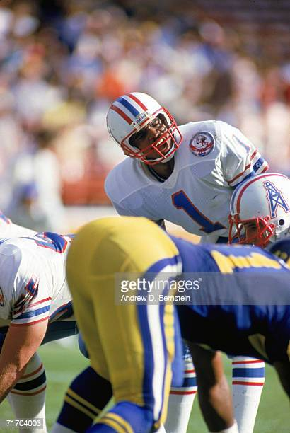 Quarterback Warren Moon of the Houston Oilers calls the play against the Los Angeles Rams at Anaheim Stadium circa 1984 in Anaheim California