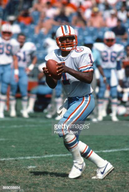 Quarterback Warren Moon of the Houston Oilers drops back to pass against the Atlanta Falcons during an NFL football game September 23 1984 at...