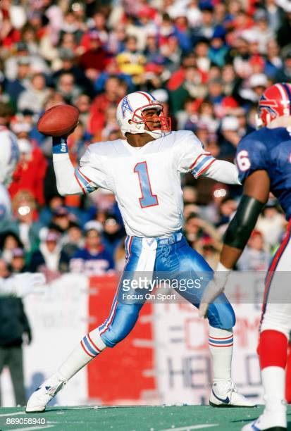 Quarterback Warren Moon of the Houston Oilers drops back to pass against the Buffalo Bills during the AFC Divisional Playoff game January 1 1989 at...
