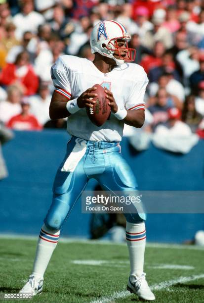 Quarterback Warren Moon of the Houston Oilers drops back to pass against the New England Patriots during an NFL football game September 22 1991 at...