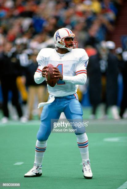 Quarterback Warren Moon of the Houston Oilers drops back to pass against the Pittsburgh Steelers during an NFL football game November 1 1992 at Three...
