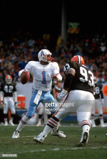 Quarterback Warren Moon of the Houston Oilers drops back to pass against the Cleveland Browns during an NFL football game November 21 1993 at...