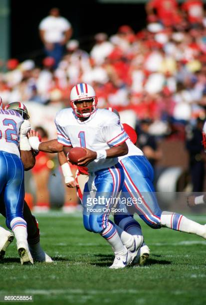 Quarterback Warren Moon of the Houston Oilers drops in action against the San Francisco 49ers during an NFL football game November 8 1987 at...
