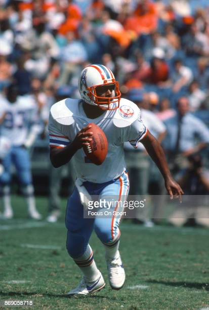 Quarterback Warren Moon of the Houston Oilers looks to pass against the Atlanta Falcons during an NFL football game September 23 1984 at...