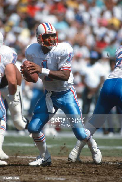 Quarterback Warren Moon of the Houston Oilers looks to pass against the San Diego Chargers during an NFL football game September 17 1989 at Jack...
