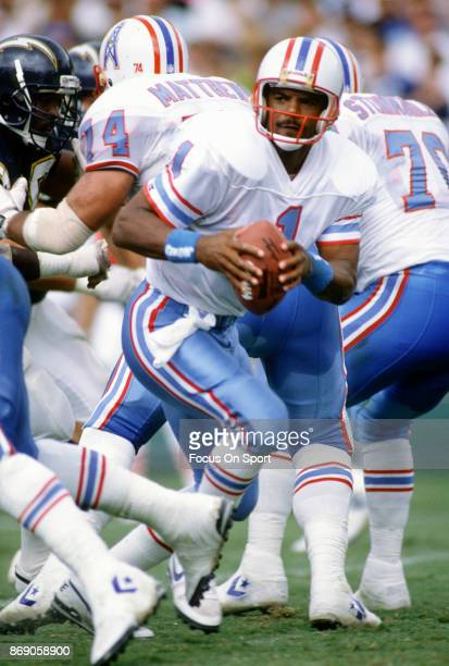 Quarterback Warren Moon of the Houston Oilers looks to pass against the San Diego Chargers during an NFL football game September 30 1990 at Jack...