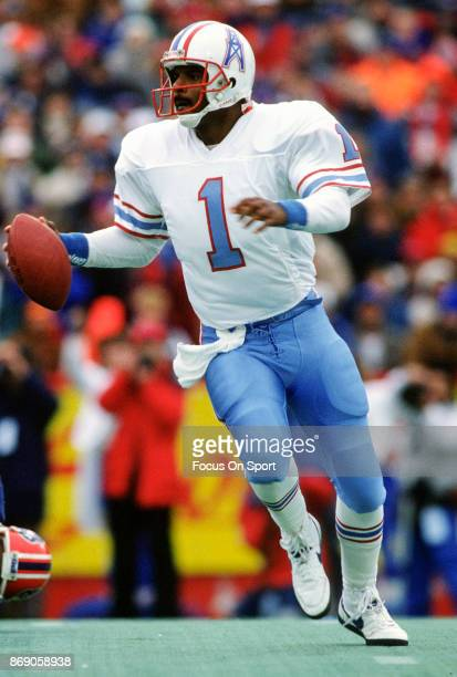 Quarterback Warren Moon of the Houston Oilers looks to pass against the Buffalo Bills during the AFC Divisional Playoff game January 1 1989 at Rich...