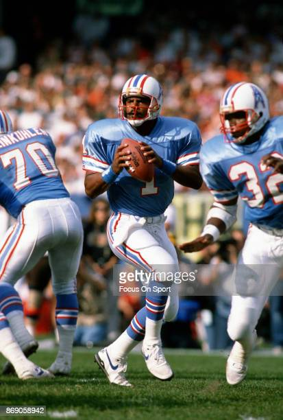 Quarterback Warren Moon of the Houston Oilers looks to pass against the Cleveland Browns during an NFL football game October 29 1989 at Cleveland...