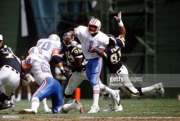 Quarterback Warren Moon of the Houston Oilers throws a pass against the San Diego Chargers during an NFL football game September 17 1989 at Jack...