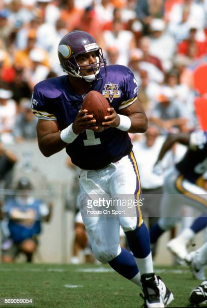 Quarterback Warren Moon of the Minnesota Vikings drops back to pass against the Tampa Bay Buccaneers during an NFL football game October 15 1995 at...