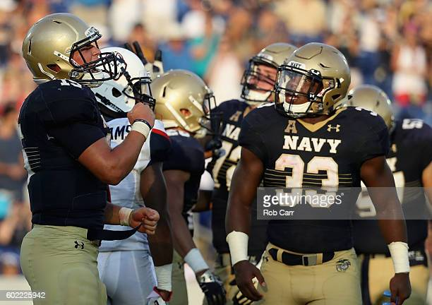 Quarterback Will Worth of the Navy Midshipmen celebrates with Chris High after rushing for a fourth quarter touchdown during Navy's 2824 win over...