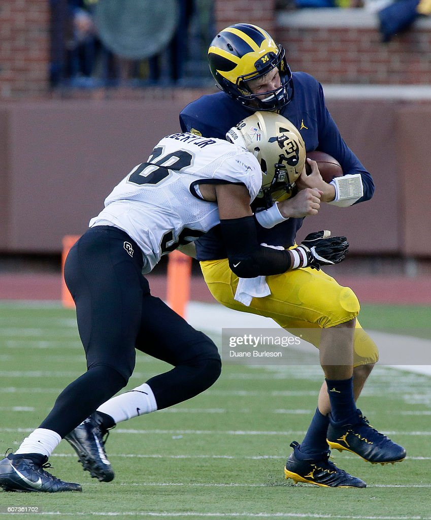 Quarterback Wilton Speight #3 of the Michigan Wolverines is hit by linebacker Jimmie Gilbert #98 of the Colorado Buffaloes during the second half at Michigan Stadium on September 17, 2016 in Ann Arbor, Michigan. Michigan defeated Colorado 45-28.