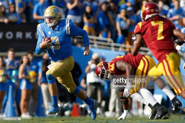 Quarterback Wilton Speight of the UCLA Bruins carries the ball for a quarterback keeper during the first half of a football game at Rose Bowl on...