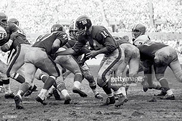 Quarterback YA Tittle of the New York Giants hands the ball to runningback Dick James during a game against the Cleveland Browns on December 12 1964...
