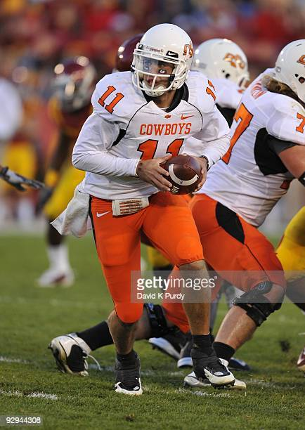 Quarterback Zac Robinson of the Oklahoma State Cowboys drops back during play against the Iowa State Cyclones in the second half of play at Jack...