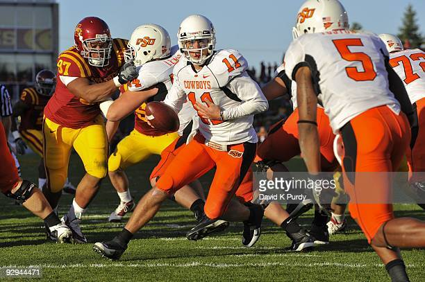 Quarterback Zac Robinson of the Oklahoma State Cowboys drops back during the game against the Iowa State Cyclones at Jack Trice Stadium on November 7...
