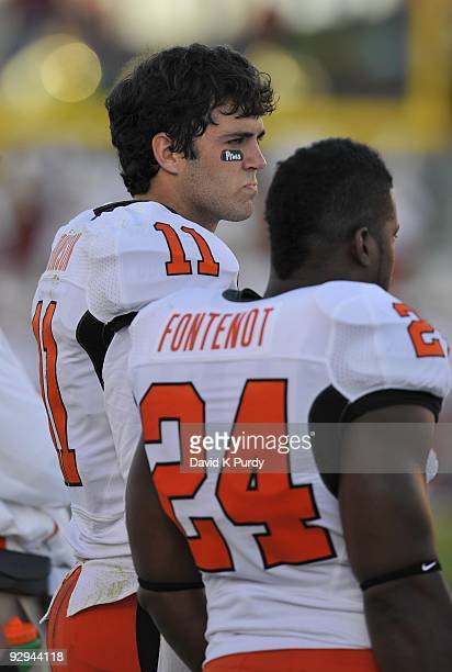 Quarterback Zac Robinson of the Oklahoma State Cowboys looks on during the game against the Iowa State Cyclones at Jack Trice Stadium on November 7,...