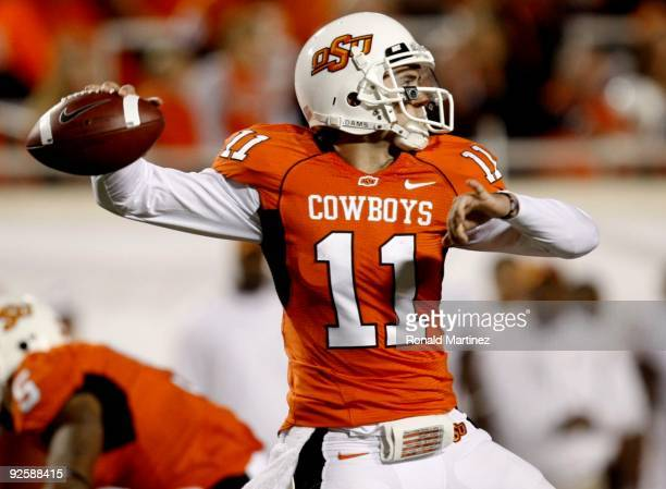 Quarterback Zac Robinson of the Oklahoma State Cowboys looks to the ball in the second quarter against the Texas Longhorns at Boone Pickens Stadium...