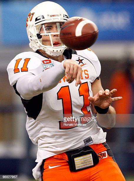Quarterback Zac Robinson of the Oklahoma State Cowboys passes against the Mississippi Rebels during the ATT Cotton Bowl on January 2 2010 at Cowboys...