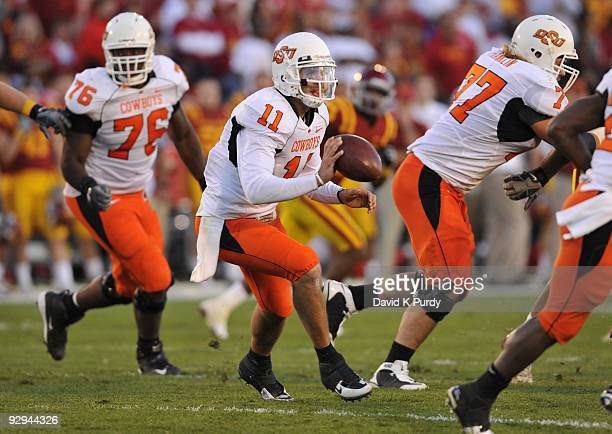 Quarterback Zac Robinson of the Oklahoma State Cowboys pitches the ball during play against the Iowa State Cyclones in the second half of play at...