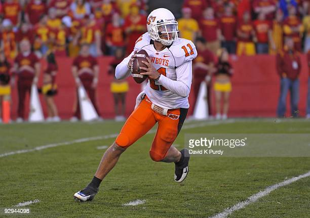 Quarterback Zac Robinson of the Oklahoma State Cowboys rolls out during play against the Iowa State Cyclones in the second half of play at Jack Trice...