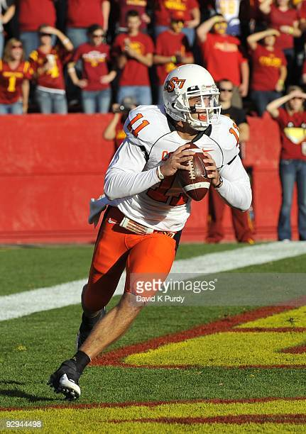 Quarterback Zac Robinson of the Oklahoma State Cowboys rolls out during the game against the Iowa State Cyclones at Jack Trice Stadium on November 7...