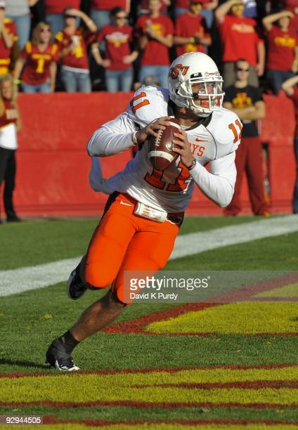 Quarterback Zac Robinson of the Oklahoma State Cowboys rolls out during the game against the Iowa State Cyclones at Jack Trice Stadium on November 7,...