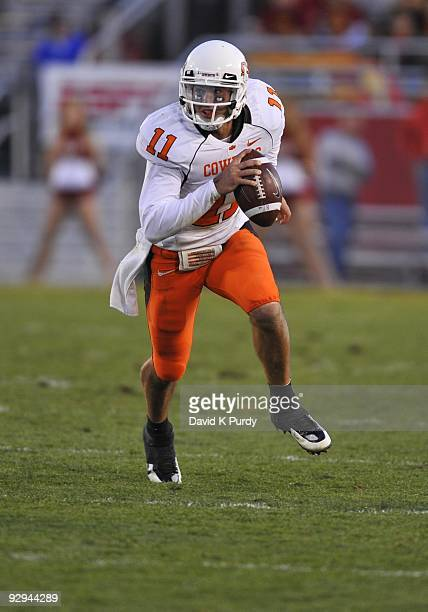Quarterback Zac Robinson of the Oklahoma State Cowboys scrambles during play against the Iowa State Cyclones in the second half of play at Jack Trice...