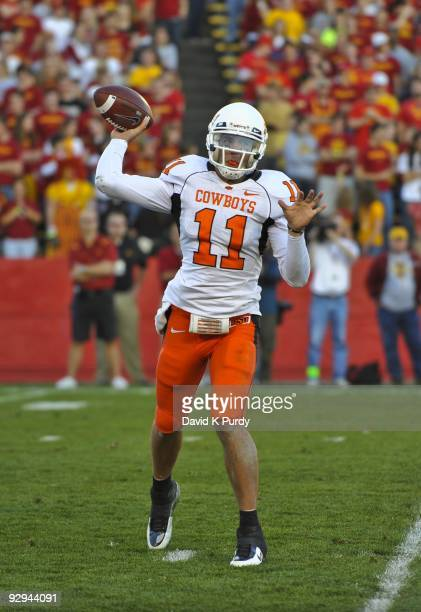 Quarterback Zac Robinson of the Oklahoma State Cowboys throws during play against the Iowa State Cyclones in the second half of play at Jack Trice...
