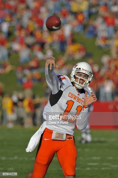 Quarterback Zac Robinson of the Oklahoma State Cowboys warms up before the game against the Iowa State Cyclones at Jack Trice Stadium on November 7,...