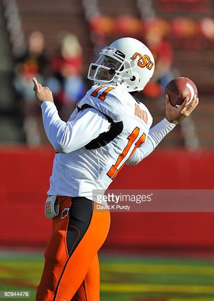 Quarterback Zac Robinson of the Oklahoma State Cowboys warms up before the game against the Iowa State Cyclones at Jack Trice Stadium on November 7...
