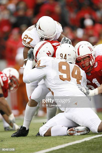 Quarterback Zac Taylor of Nebraska is sacked by Michael Griffin and Thomas Marshall during action between the Texas Longhorns and Nebraska...