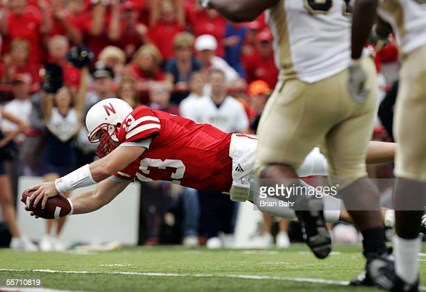 Quarterback Zac Taylor of the Nebraska Cornhuskers dives into the endzone for a touchdown against the Pittsburgh Panthers in the second quarter on...