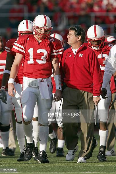 Quarterback Zac Taylor of the Nebraska Cornhuskers listens to head coach Bill Callahan before the game against the Colorado Buffaloes on November 24...