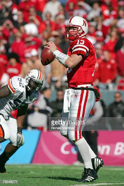 Quarterback Zac Taylor of the Nebraska Cornhuskers looks to pass the ball downfield during the ATT Cotton Bowl Classic against the Auburn Tigers on...