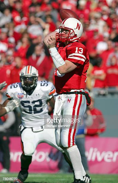 Quarterback Zac Taylor of the Nebraska Cornhuskers passes the ball downfield during the ATT Cotton Bowl Classic against the Auburn Tigers on January...