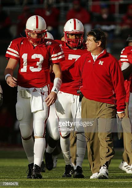 Quarterback Zac Taylor walks the edge of the field with head coach Bill Callahan of the Nebraska Cornhuskers at the end of the first quarter against...