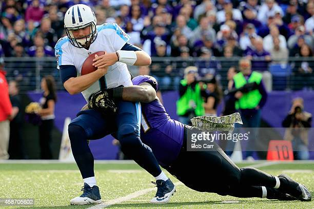 Quarterback Zach Mettenberger of the Tennessee Titans is sacked by defensive tackle Timmy Jernigan of the Baltimore Ravens during the first half of a...